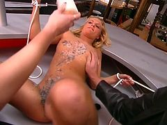 A woman spills hot wax all over the body of a tied-up blonde girl before a man rip her pussy from behind.