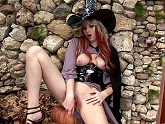 Share this with your friends! Watch this long haired babe, with big boobs wearing a witch costume, while she rubs her pussy with passion.