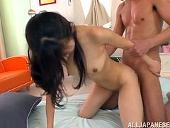 Slim Japanese cutie Rimu Sasahara is having fun with two dudes in a hot MMF sex vid. She pleases the guys with a blowjob and then gets her snatch pounded doggy style.