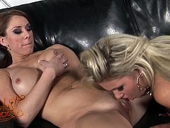 This spoiled chick with huge tits needs a good pussy workout so she spreads her legs wide to let her lesbian GF fuck her snatch with her dildo.