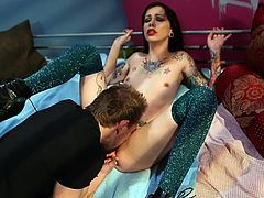 Watch this tattooed babe screaming with a huge dick up her tight vag