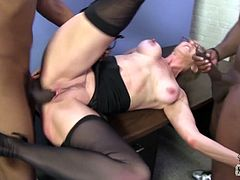 Salacious blonde cougar Jenna Covelli is having fun with two black men indoors. She sucks and rubs their boners and then gets her cunt drilled in cowgirl and missionary positions.