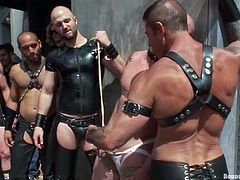Have a good time watching these homosexuals, with yummy asses wearing leather clothes, while they torture each other in the middle of the street.