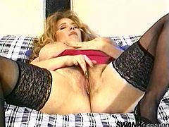 Touch yourself watching this blonde lady, with a nice ass wearing nylon stockings, while she masturbates in a hot solo model video.