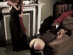 Desirable maid looks extremely seductive wearing uniform. Red haired mistress ordered her to bend over the couch so she followed all instructions. Kinky dominatrix whipped dark head hottie.