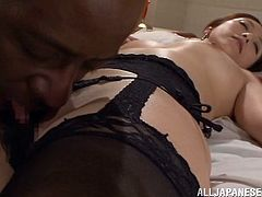 Sexy Japanese milf is playing dirty games with a black dude. They pet each other and have oral sex and then bang in missionary position and doggy style.