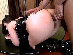 A cock-thirsty brunette slut sucks on a hard cock and fuckin' gets it shoved in her cunt but not without suckin' on it first...and after!