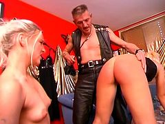 Older dude play some bdsm games with two hot sexy blondes whipping their asses, candle-waxing and fucking them.