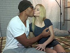 Check this blonde babe, with small boobs wearing a miniskirt, while she goes really hardcore with a hot black guy in a reality video.