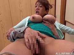 This MILF has amazing big boobs and she's gettin' totally fondled and fuckin' fingered by this fucker right here! Hit play and check it out!