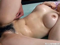 Slutty Japanese girl Miki Yoshimura wearing a bikini lets two men pour oil on her big natural tits and pussy. Then the guys drill Miki's cunt doggy style and in missionary position and she enjoys it much.
