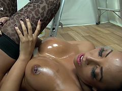 Raven haired filthy sex doll with eye catching figure lies on floor with her legs spread apart and gets her hot kitty fisted by that fat slutty woman tough. Watch these dirty bitches in Porn XN sex video!