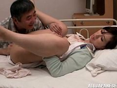 This dirty Japanese nurse cares about her patients so much that she is even willing to let them take advantage of her. One of her feeble patients manages to get the upper hand on her and pushes her against the bed. He spreads her legs and fingers her hairy pussy.