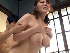 Her amazing tits swing as this sexy Japanese girl gets on top of a guy and rides his cock until she cums all over his shaft.
