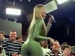 Big Boobs blonde in green spandex