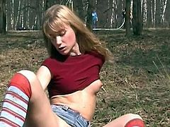 Check out nude teen stroking her pussy in hot outdoor solo