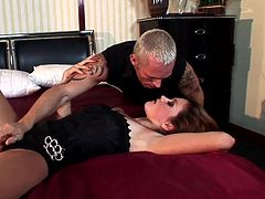 Be part of this video where a brunette babe, with natural breasts wearing long boots, while she gets banged hard by a tattooed man over a bed.