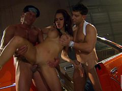 A slutty chick with big fake tits sucks two cocks passionately. She simply can't do it in other way. Then Daisy gets her pussy fucked rough two times in a row.