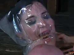 Sybil Hawthorne is tied up in restrains that no one but Sister Dee can undo. SD wraps Sybil's face in foil, fucks her mouth with a toy and inflicts pain on her boobs.