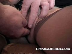A granny gets hypnotized into fucking a naughty guy. They start on a casual talk while the guy hypnotize her then stroke her shaved snatch then ended up making love in the bedroom.
