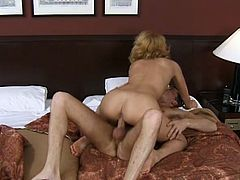 Charming blonde Katalyn and her man are having a good time in a bedroom. They pet each other and then have fervent doggy style sex.