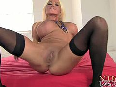 Blonde milf spreading her legs for masturbating.