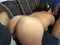 Adorable curly-haired chick Jackie is trying her best to please two men. She sucks and rubs their boners and gets her pussy pounded hard doggy style.