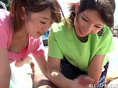 Pretty Japanese girls give a handjob and a blowjob outdoors