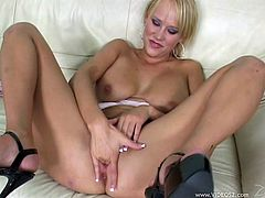 A blonde chick in panties and high heels fingers her pussy lying on a sofa. Then Carly gets her asshole licked and fucked. Carly gets face fucked as well.