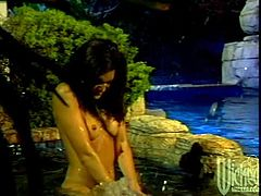 Make sure you get a load of this hardcore scene where this horny brunette's fucked silly by this guy after sucking hism big cock in the pool.