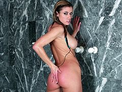Sizzling Randy Moore shows her hot ass while taking a shower. Then she takes off a bikini and toys her pink pussy with a glass dildo.