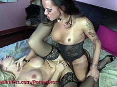 See an alluring brunette shemale wearing black stockings while pounding a hot blonde's pink pussy into a breathtaking orgasm.