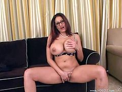A busty cougar in glasses gives a titjob and rides a dick