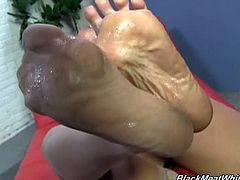 Horny blonde MILF Alura Jenson is about to give this lucky black dude an amazing footjob. She knows how to make him feel like crazy and does it really good.
