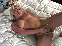 Adrianna lays back on her bed and pulls her big tits to her mouth so she can lick them before using her fingers to make her pussy cum.