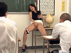 Naughty Sayuri Honjyou lifts up a dress and takes the panties off right in a classroom. Sayuri fingers herself and then gets blowbanged by her students.