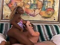 White dude is spending unforgettable time with black hottie. The busty African chick with blond hair shows her boobs before starting to suck fat rod of the pal so well.