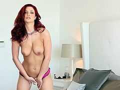 This gorgeous redhead in high heels can hypnotize any man with her beauty. She slides her fingers inside her wet pussy and starts pumping them in and out until she reaches body shaking orgasms.