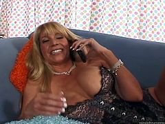Check out this big boobed and bootylicious MILF in sexy lingerie gettting her hairy cooch licked good by her younger boyfriend.