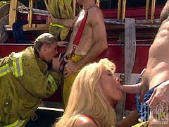 Slutty blondes Jill Kelly and Sindee Coxx are trying hard to please three dudes. The bitches suck and rub the men's cocks and then get their pussies pounded from behind.