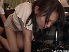 Busty Japanese bitch Chizuru Sakura wearing panties is having fun with some dude indoors. The man plays with Chizuru's nice natural tits, fingers her cunt and then uses her face as a cum target.