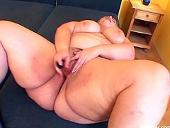 Iveta is an obese mature woman. She has blonde hair and massive jugs. Her favorite toy is a golden vibrator that she shoves in her mouth and cunt hole to masturbate.