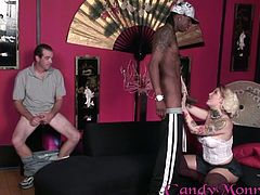 Slutty blonde Candy spanks some dude's butt. Then she sucks and rides a black dude's cock in the presence of this man and enjoys it much.