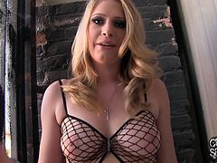 Allie loves getting naked so much she was walking around backstage at her photo shoot wearing nothing but a sexy fishnet bodysuit.
