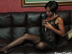 Checkout this sexy brunette ebony babe named as Evanni Solei in this hot video.See how this sexy babe strips off her clothes and show you her black tits and that tight black cunt, which she masturbates nicely on a black couch.