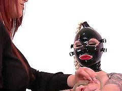 Bosomy blonde slut Angel Deelight gets herself into a leather bound, bondage predicament, completely helpless and at the mercy of Paige Delight who whips her ass mercilessly.
