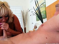 Busty cougar Tara Holiday rides Seth Gamble in a cowgirl position