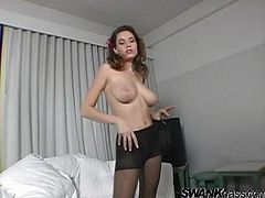 Amazing cutie Jamie Lynn wearing a bra and pantyhose is having a good time alone. She strokes her terrific body and then massages her beautiful tits and shaved pussy.