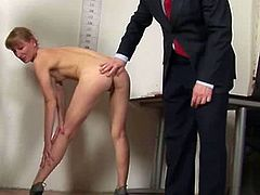 This is not a regular job interview. A European blonde chick is told to take off her clothes by two interviewers. She obeys and she even inserts a speculum in her pussy for them.