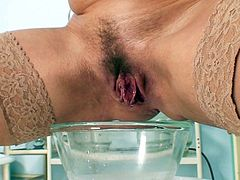 The need to stimulate her hairy cunt is so high that mature nurse starts playing at work